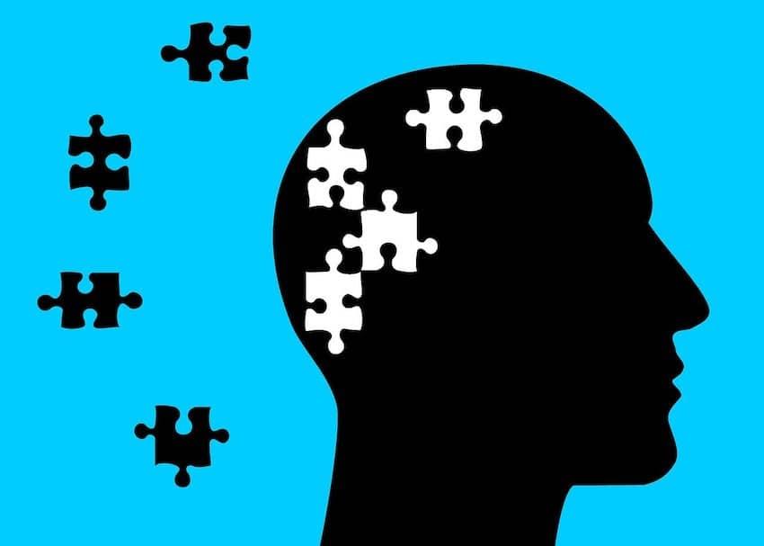 Hypnose gegen innere Blockaden, Kopf mit den Puzzele für die Lösung
